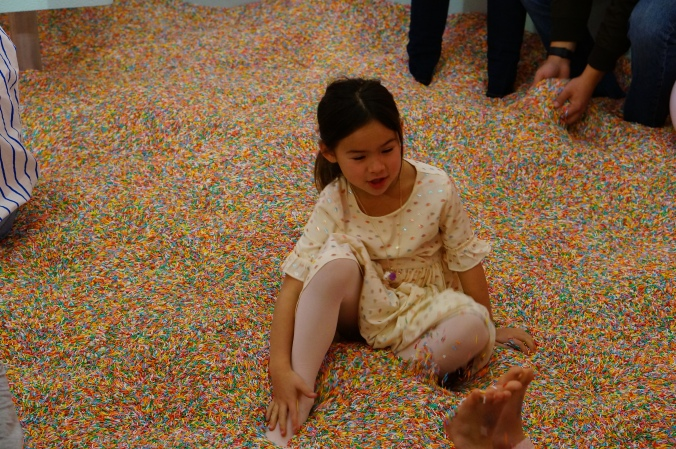 A child's joy in the sprinkle pool at the Museum of Ice Cream (2018)